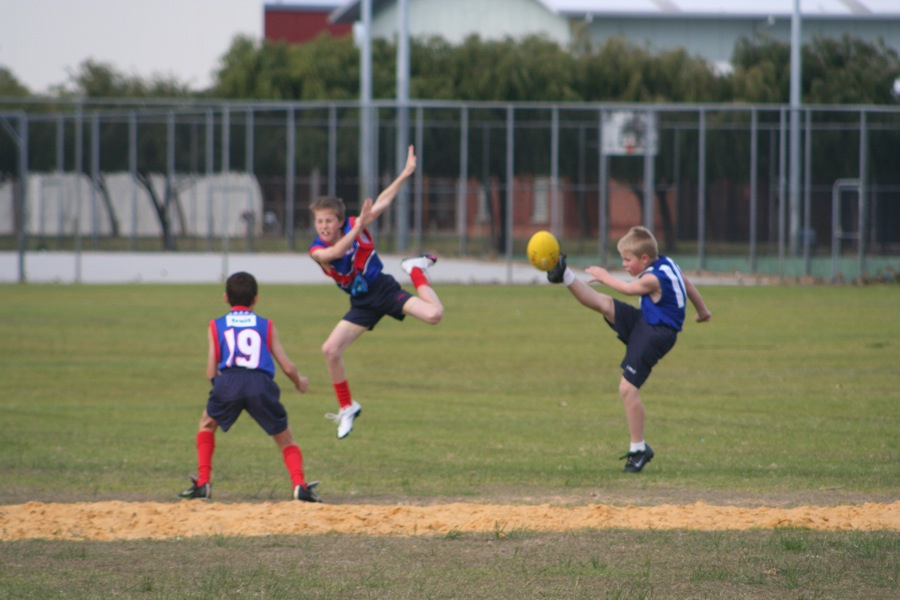 Dane kicks footy
