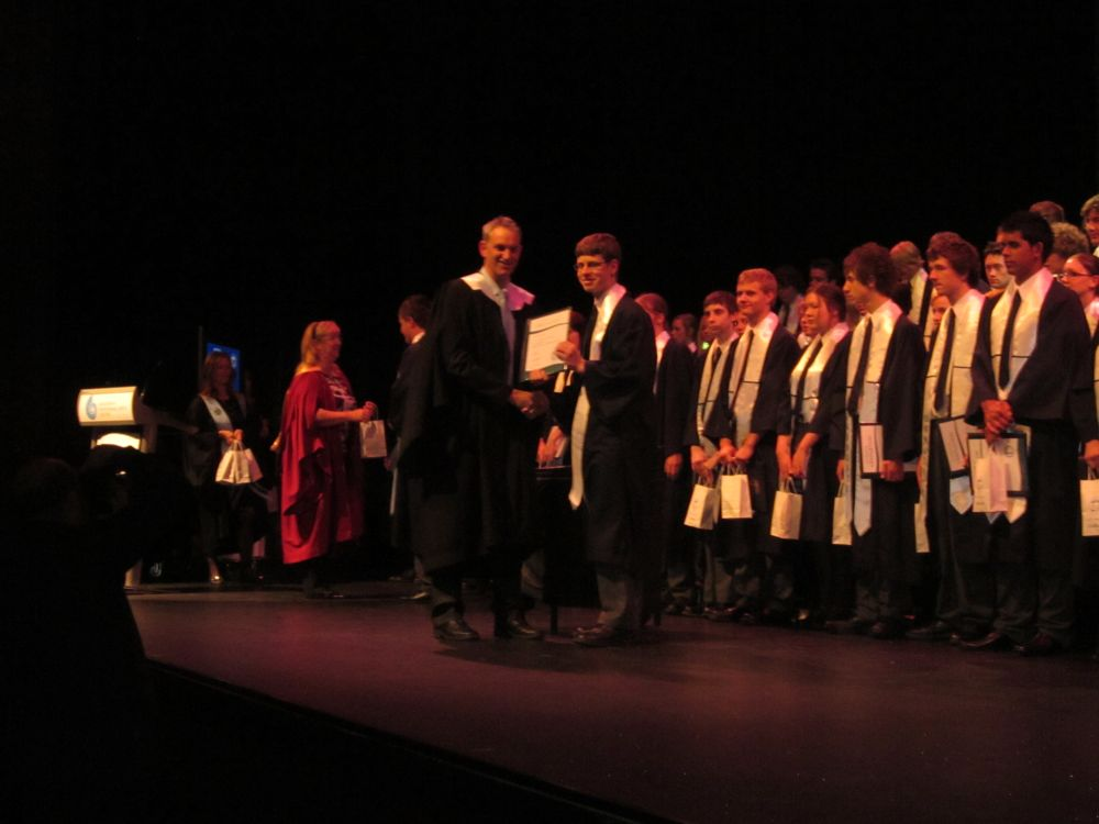 Peter receives diploma